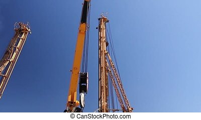 Mobile crane on truck is loading - Mobile crane is operating...