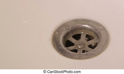Clogged Sink In a Bathroom - Water running out of the faucet...