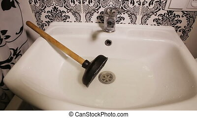 Sink and a Plunger - clogged sink and a plunger