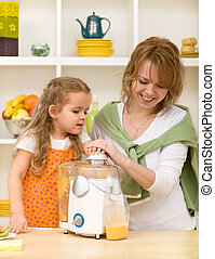 Making fruit juice with mom