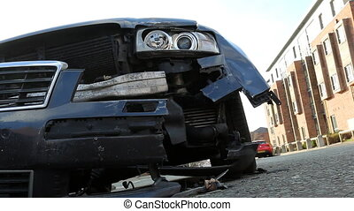 Car after accident on the street - Low angle shot of damaged...