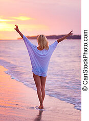 Lady on sandy tropical beach at sunset - Beautiful blonde...