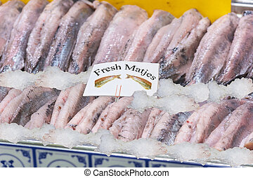 Fresh Matjes fish on ice cooled to the fish market