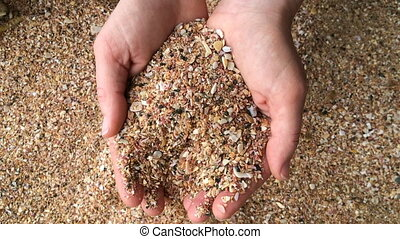 Woman hands play with sand