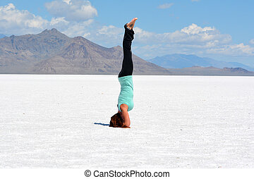 Headstand Yoga Pose - Beautiful young woman doing a yoga...