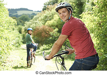 Young Couple On Cycle Ride In Countryside