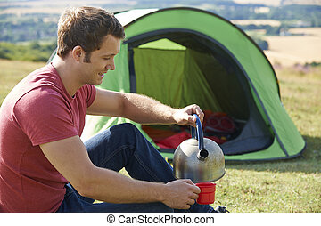 Young Man Camping In The Countryside