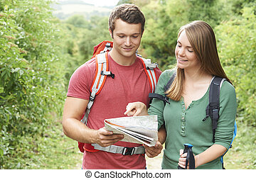 Young Couple Hiking In The Countryside