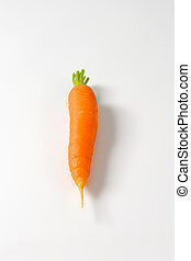 Whole organic carrot - Raw carrot on white background