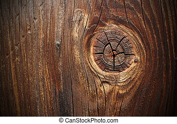 big knot on spruce plank, wood background
