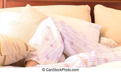 Brunette woman lying on sofa