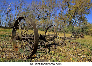 Old wood wagon wheels - Old rusty steel spoken wagon wheels...
