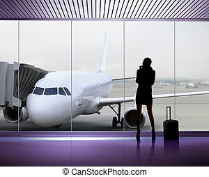 Silhouette of woman at the airport - silhouette of...