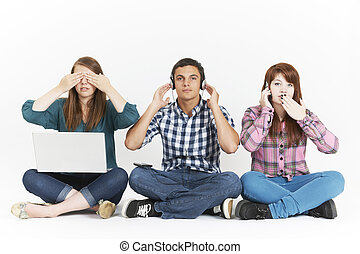 Teenagers In 3 Wise Monkeys Pose Holding Gadgets