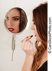 Young girl making makeup in bathroom Woman take care about...