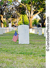 Gravestone with American flag at Beaufort National Cemetery...
