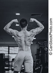 Detail Of A Bodybuilder Posing In The Gym