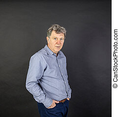 portrait of fifty year old man showing emotions - fifty...