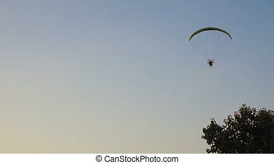 paramotoring soaring over river - Telephoto shot of a...