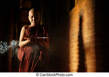 Buddhist novices learning - Young novice monk learning...