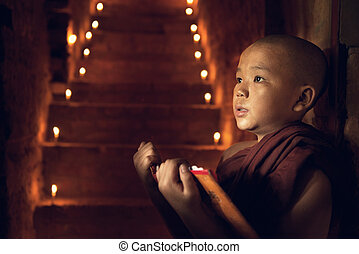 Buddhist novice monk learning in monastery - Young Buddhist...