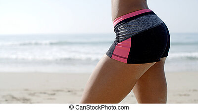 Woman In Black Panties - Bottom of a lady in fitness wear...