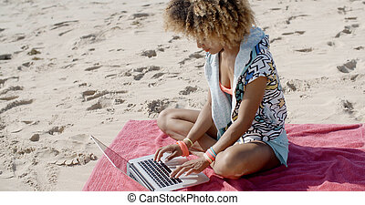 Woman With Laptop On The Summer Beach