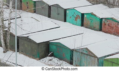 Row of old school garages in winter