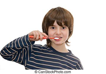 boy brushing teeth, isolated on white