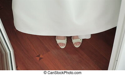 Bride in wedding shoes stepping - Bride in wedding shoes...
