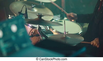 Drummer playing drum set at a party Close-up