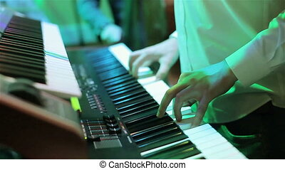 Musician playing keyboard at party