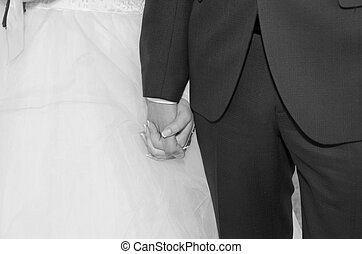 The hands of the bride and groom before marriage