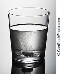 Glass with effervescent tablet in water