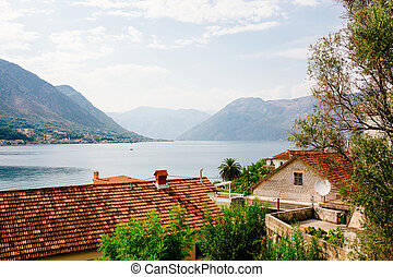 Harbor and ancient buildings in sunny day at Boka Kotor bay...