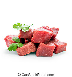 Pile of juicy beef cubes, macro, soft focus