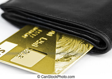 Gold bank card in a purse - Gold bank card in a black wallet...
