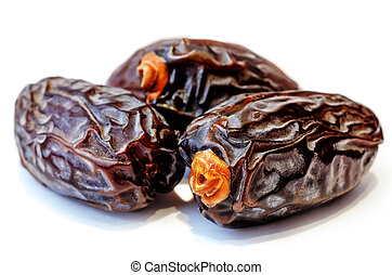 medjool dates on a white background