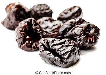 prunes on a white background tinting selective focus
