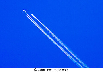Areoplane - A passenger jet leaving a vapour trail in a blue...