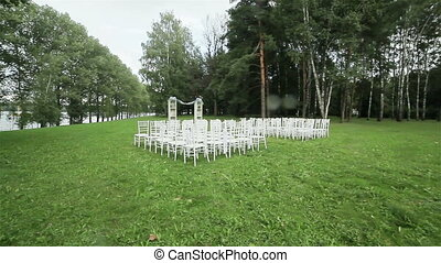 Chairs on lawn ready for wedding - Rows of chairs on lawn...