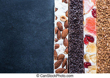 Nougat bars on dark background, copy space - Traditional...