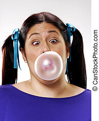 Gum girl - Young girl doing a bubble gum.