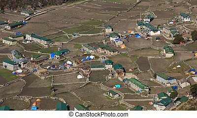 Houses and field in the Sherpa village Khumjung Sad scene...