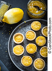 Portugese mini lemon custard tarts, with lemon curd and...