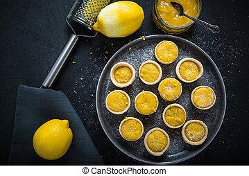 Portugese mini lemon custard tarts, with lemon curd and...