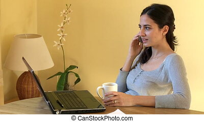 A woman on phone - Serious woman on phone working at a...