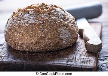 Sliced artisan bread loaf - Homemade bread loaf with vintage...