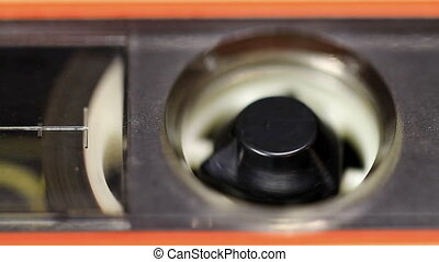 Cassette Tape Macro - Close up of audio cassette tape in use...