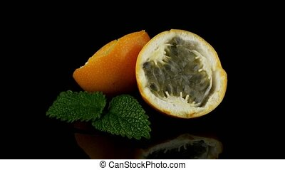 Passion fruit maracuja granadilla on black background